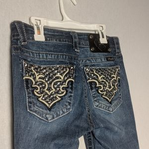 Miss Me Mid Rise Bootcut Jeans